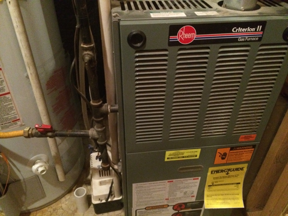 Latham, NY - Preventive maintenance on a Rheem gas furnace