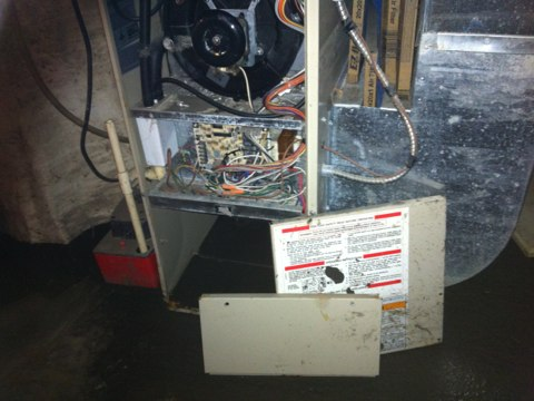 Herkimer, NY - Gas furnace inspection required due to flooding. Advised the homeowner that he needs to replace his gas furnace due to flood damage since the manufacturer voids all warranty and liability when controls are submerged under water for any period of time.