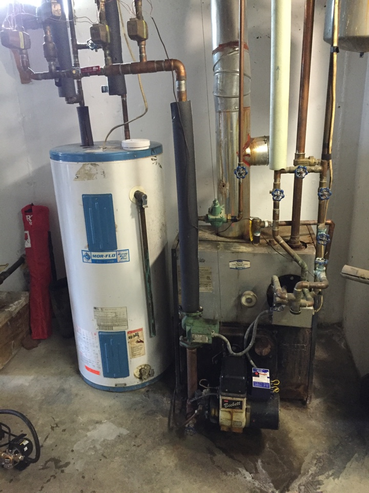 Duanesburg, NY - Oil boiler and electric hot water heater replacement. Replaced existing oil boiler with new Lennox 84% efficient oil boiler and Rheem electric hot water heater.