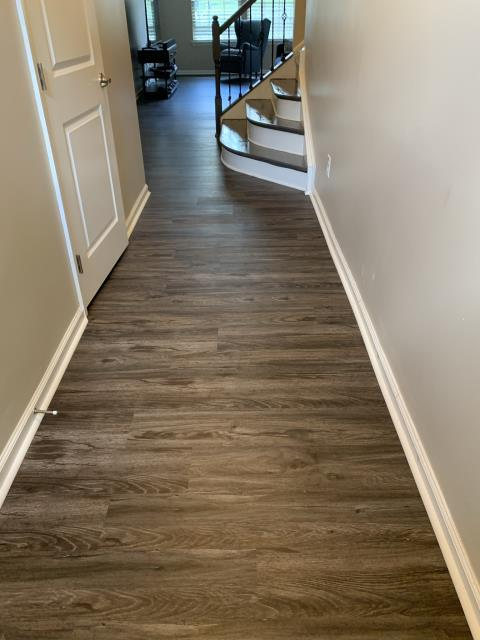 Charlotte, NC - Beautiful luxury vinyl plank installation and stained hardwood steps to match for excellent customers in downtown Charlotte, NC!
