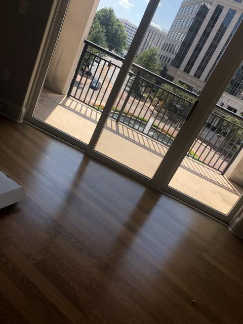 Charlotte, NC - Installation of prefinished glue down engineered hardwood flooring in a beautiful condo in Southpark! Check out this view!