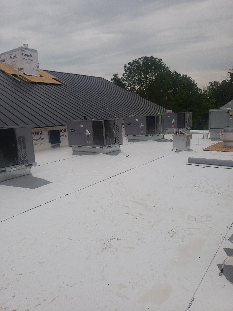 London, OH - Laying PVC on a flat roof this morning