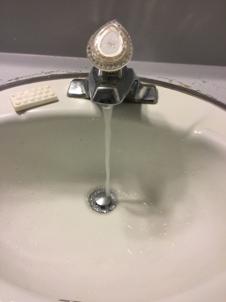 Cleared plugged sink drain.