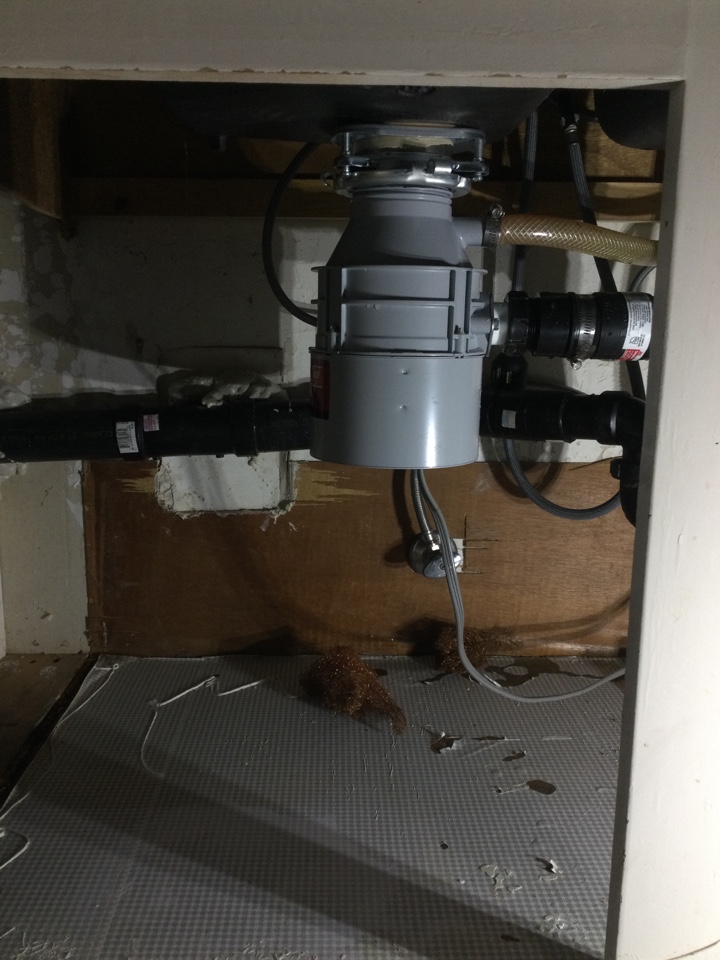 Santa Cruz, CA - Replaced food waste disposer and located a leak under a dish washer.