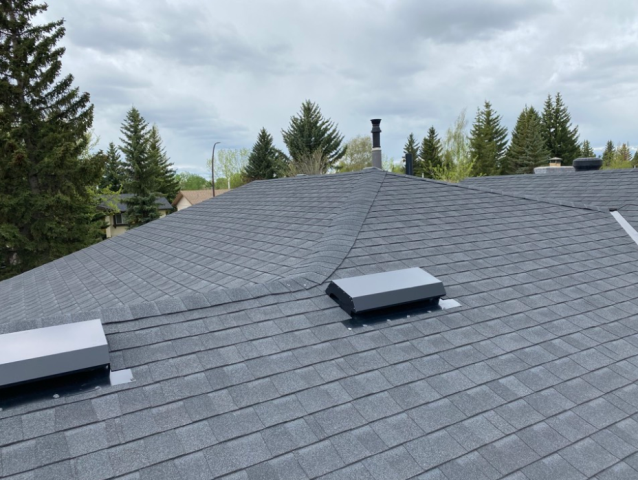 Airdrie, AB - Completed fiberglass asphalt roof repair and roof installation for a client. We also installed premium Royal woodlands vinyl siding