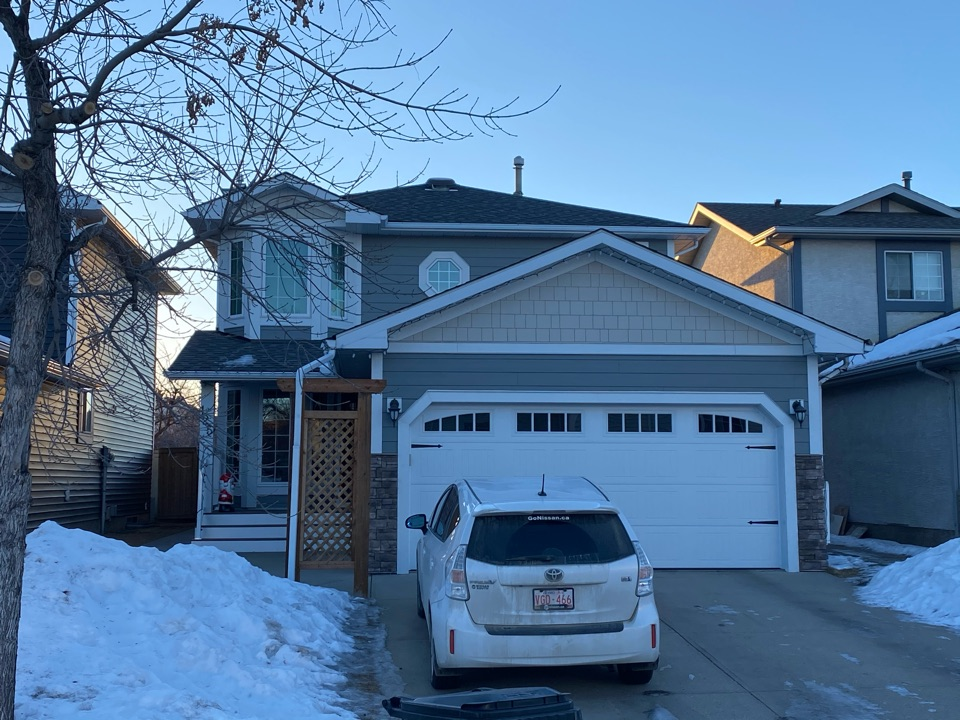 Calgary, AB - James Hardie siding and new energy efficient vinyl windows. Installed and happy clients