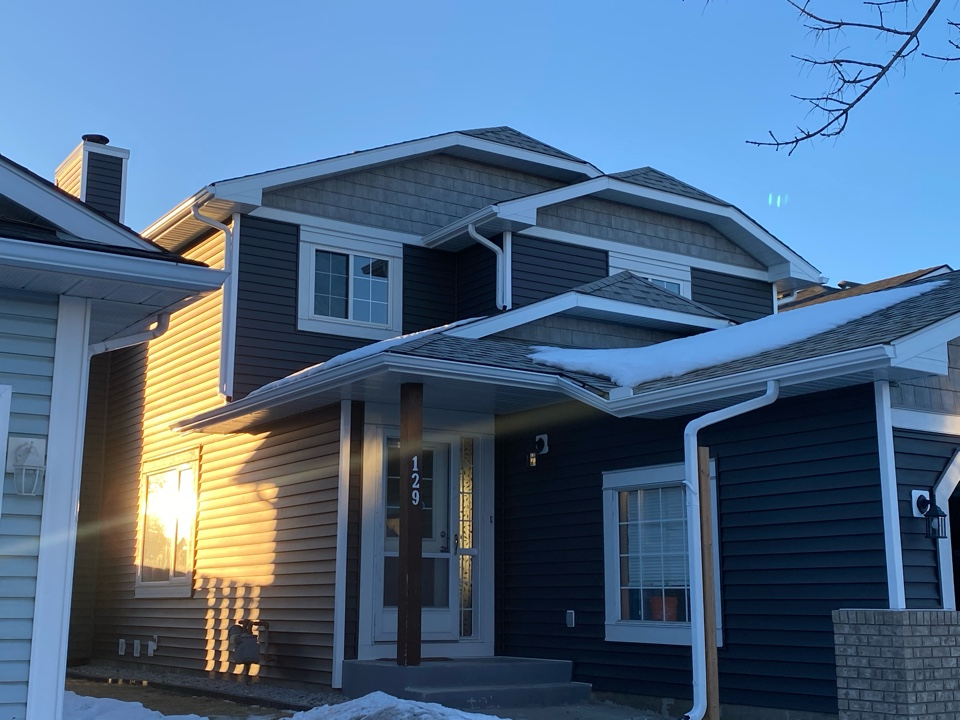 Calgary, AB - The neighbour to our James Hardie job chose some beautiful Royal Woodlands siding, new Hardie trim and new soffit fascia and eaves. Updating their home with a very modern look