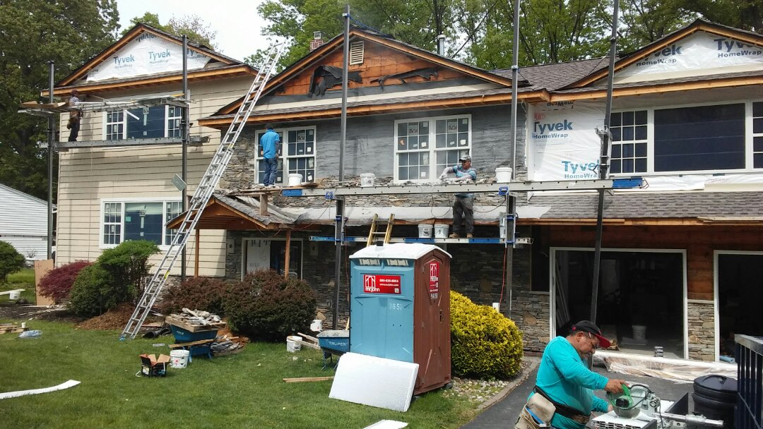 Wayne, NJ - Installing siding and stone on a house.