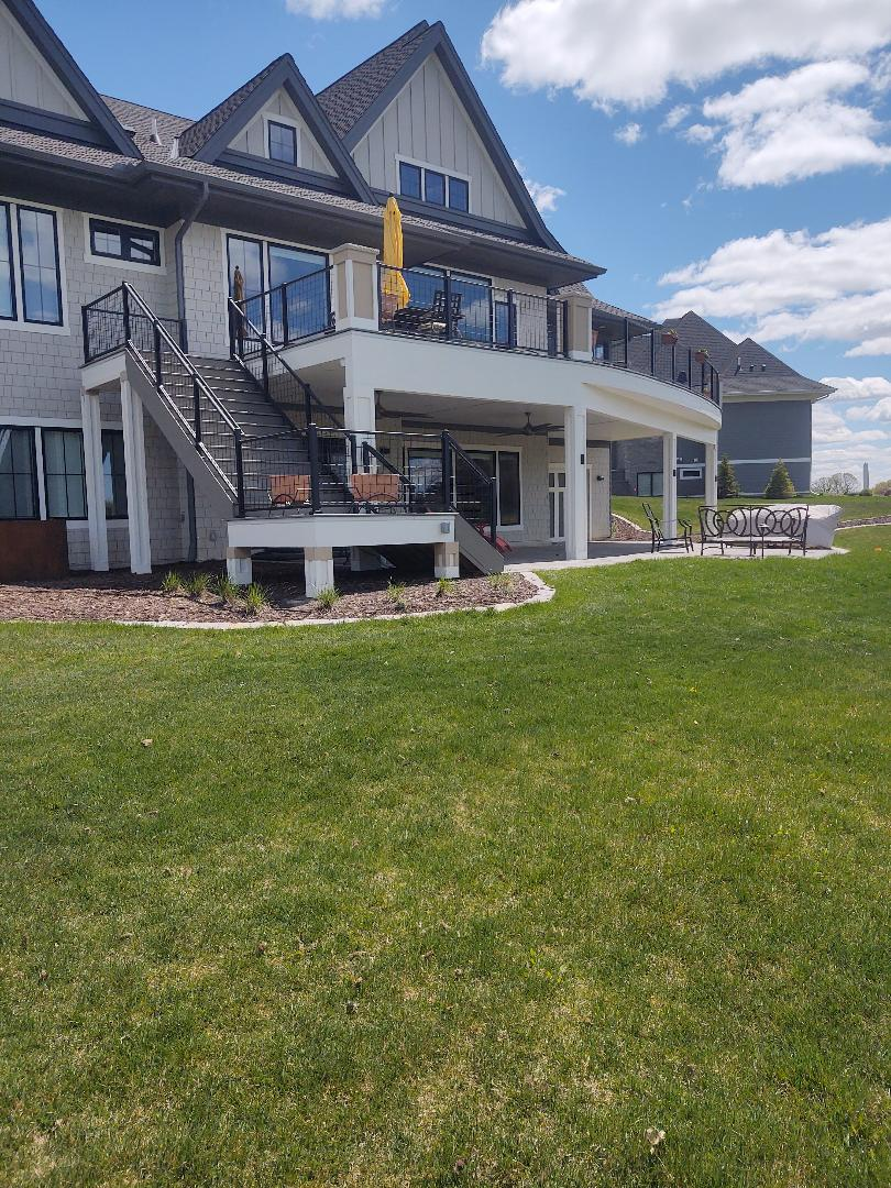 Lake Elmo, MN - Putting the finishing touches on a beautiful deck overlooking the golf course!