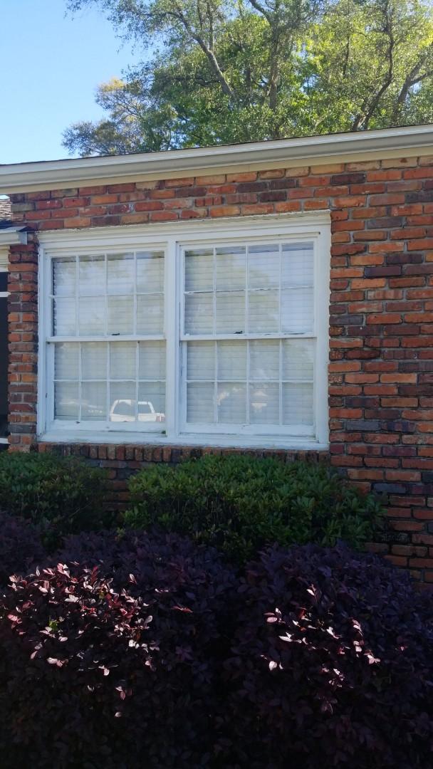 taking out old wood sash windows in Pensacola