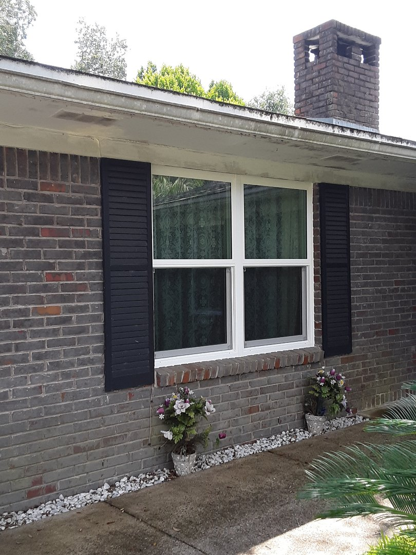 Beautiful new white vinyl impact rated no grid Windows made by Shwinco.