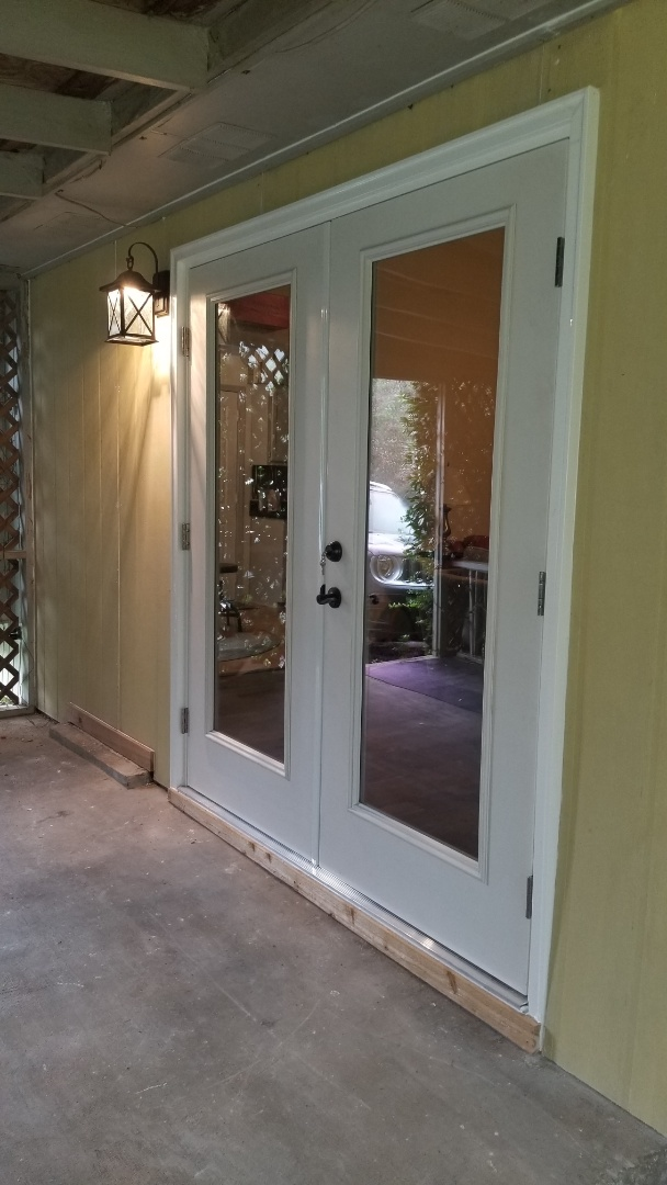 took out old ugly windows and put in a new French door near Daphne, Al