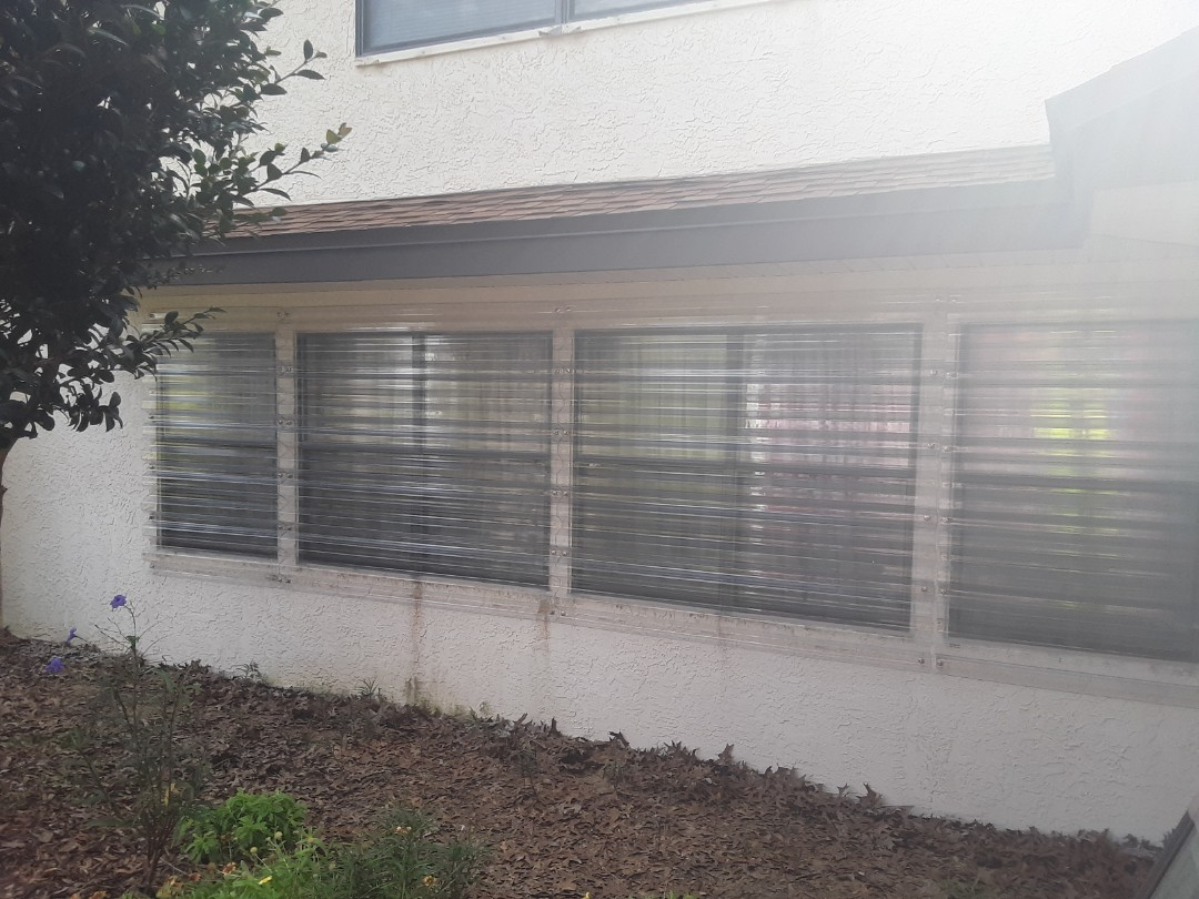 Replacement  windows and storm shutters