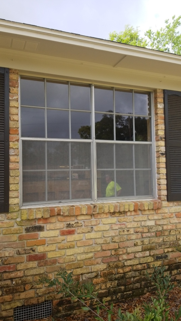 taking out old inefficient single pane windows in Pensacola