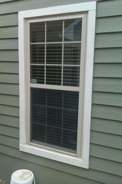 Molino, FL - Folkers installation crew began customer's job by removing their old fifteen outdated windows. After preparing each opening, they began installing fifteen Viwinco double hung white argon low e non impact  windows, providing additional energy savings for our customer