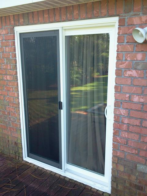 Cut out the brick wall and installed sliding glass door Shwinco impact