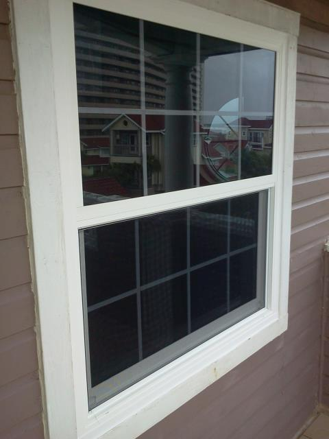 Cantonment, FL - We discussed white vinyl locally argon windows with shutters for this customer