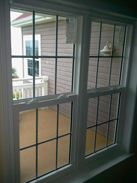 Talked about our white windows with grids single hung shwinco for this customer