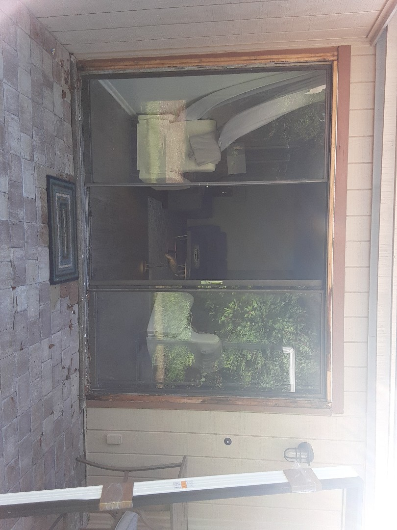 Miramar Beach, FL - Removed and replaced a three panel sliding glass door