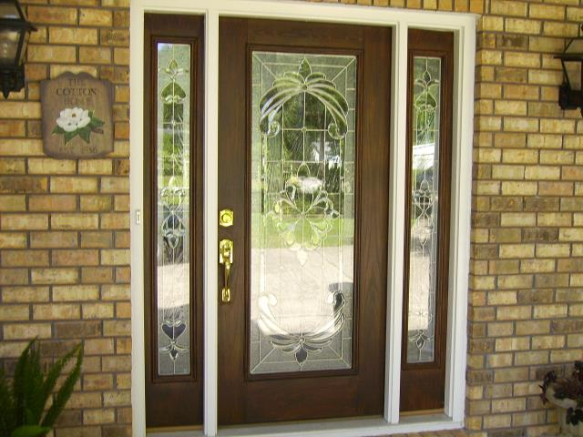 Milton, FL - Large entry door with two sidelights impact fiberglass door Boise Cascade.