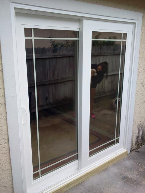 Milton, FL - Cut out the stucco wall and installed sliding glass door impact