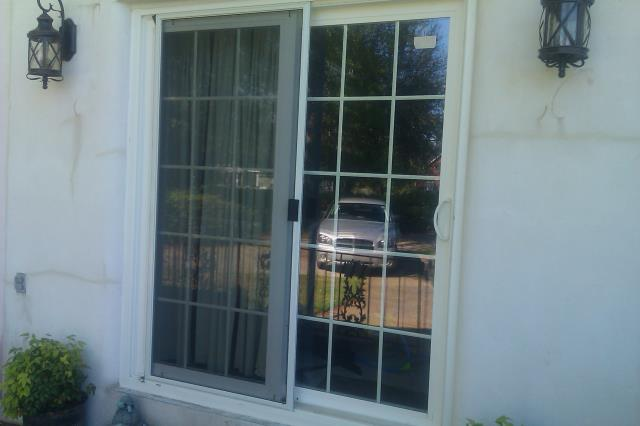 Navarre, FL - Installed a sliding glass door with grids