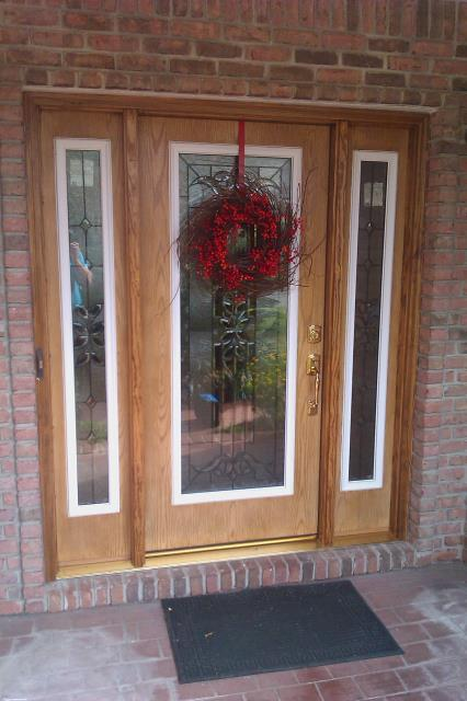 Installed front door and two side lights