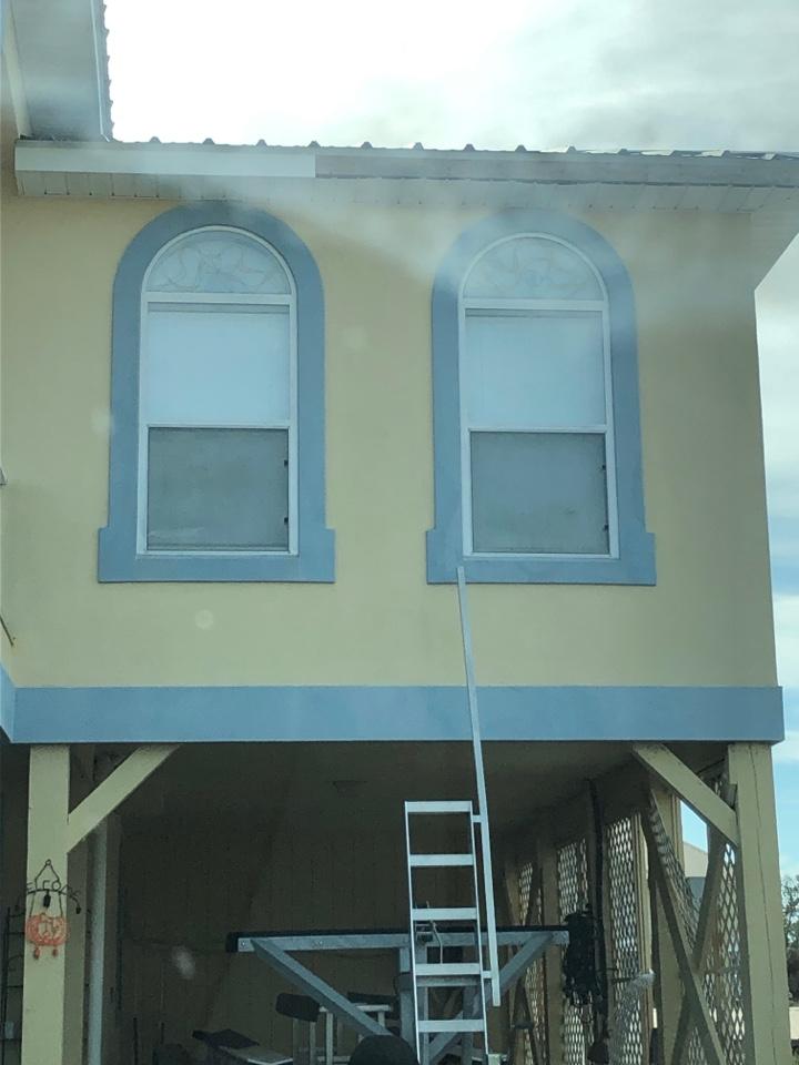 Orange Beach, AL - Measuring for impact windows and doors