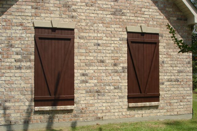 Destin, FL - Installed twelve hurricane protection Colonial shutters