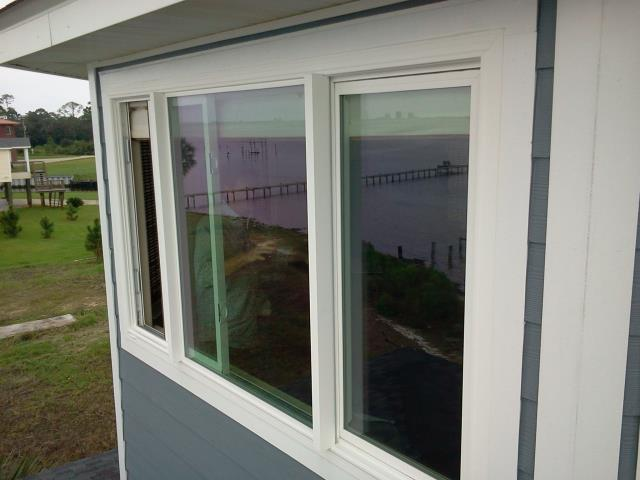 Freeport, FL - Installing five sliding Shwinco windows