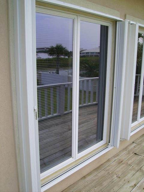 Theodore, AL - Installed hurricane protection accordion shutters on all windows and roll down on entry door and sliding glass door