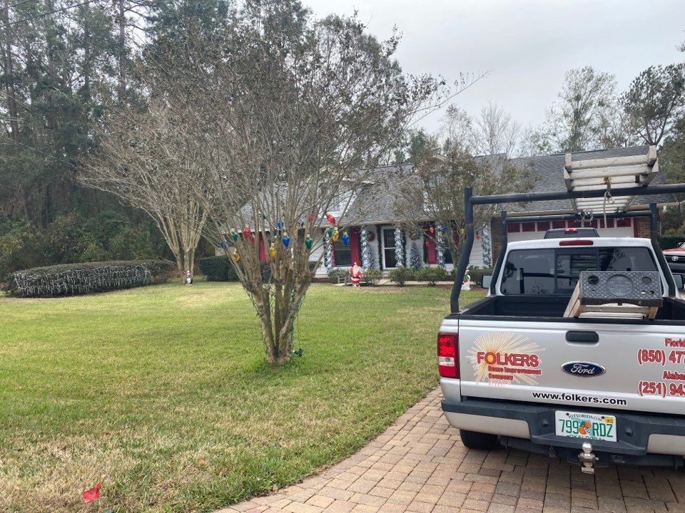Pace, FL - Measuring for impact replacement Viwinco single hung windows and fixed picture windows in pace Florida