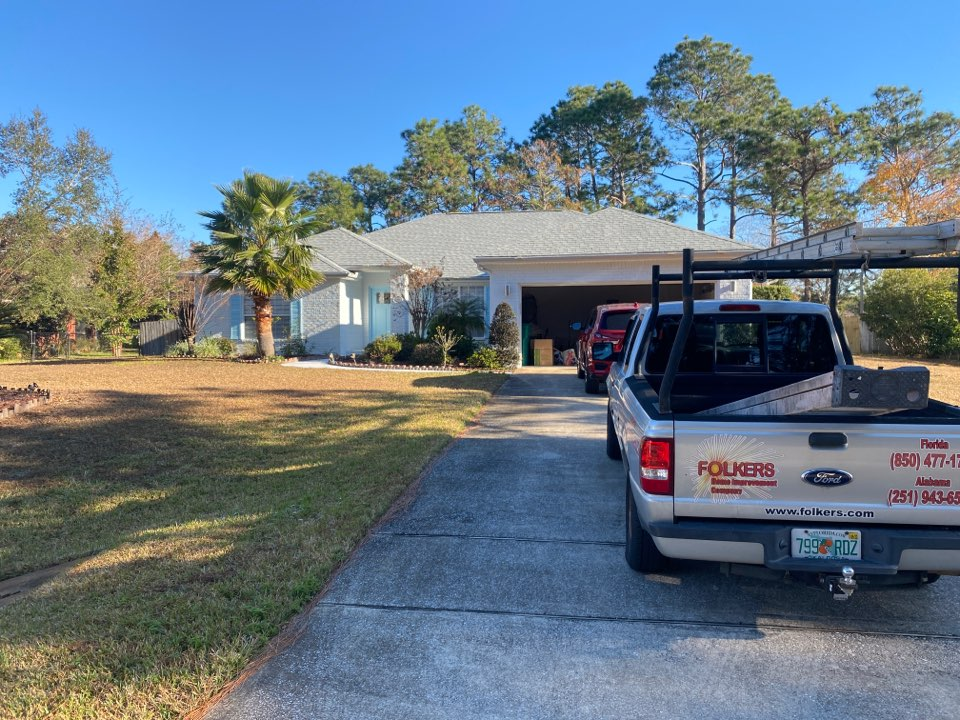 Navarre, FL - Measuring for impact replacement shwinco single hung windows, fixed picture windows and sliding glass doors in Navarre Florida