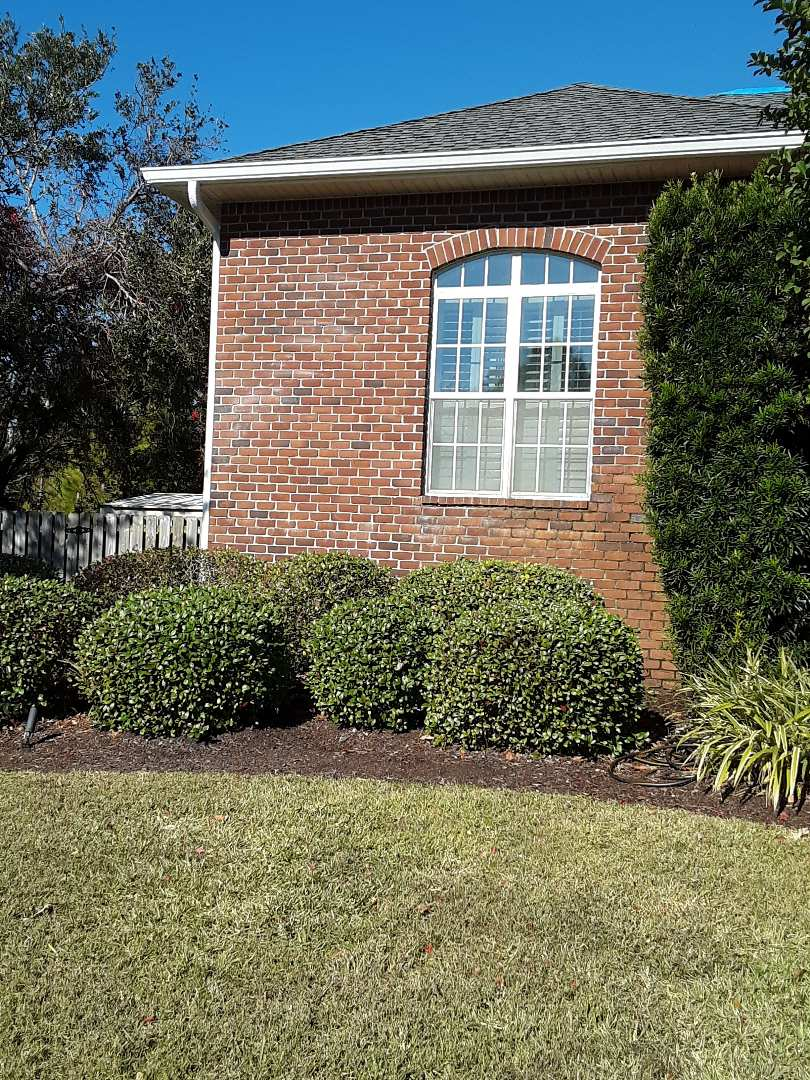 Gulf Breeze, FL - New white vinyl low-e argon single hung windows with grids for this home