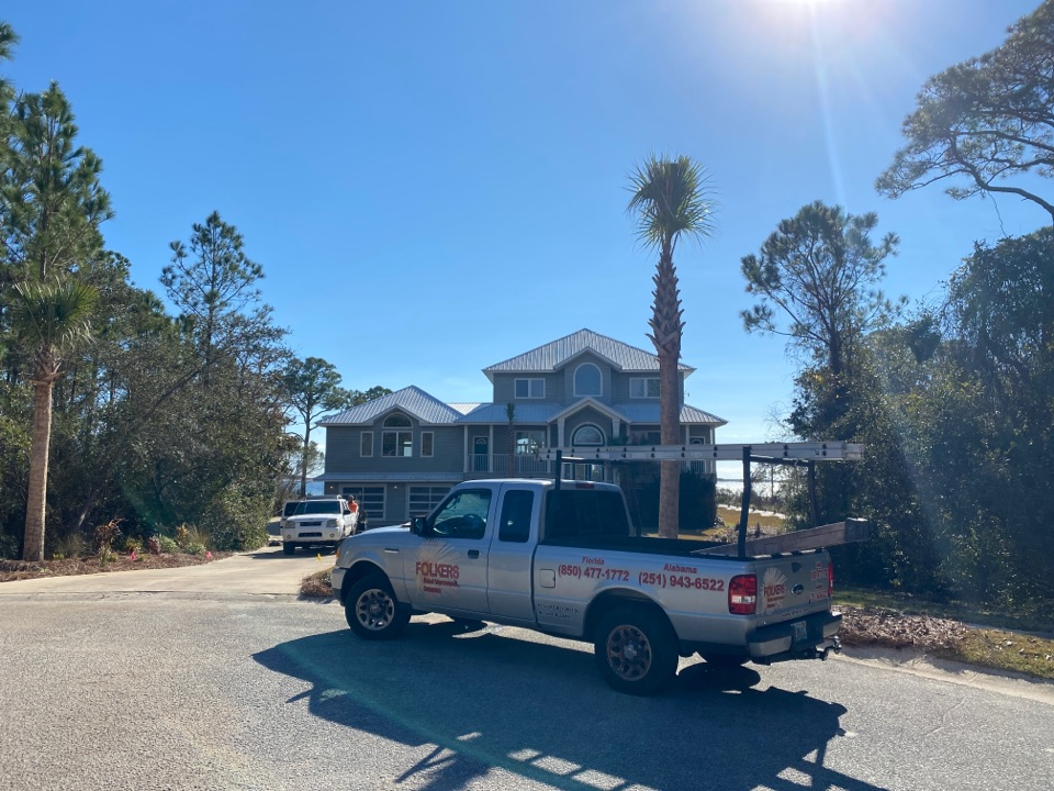 Navarre, FL - Measuring for impact replacement custom window systems casement windows and fixed picture windows and sliding glass doors in navarre Florida
