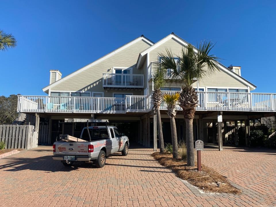 Santa Rosa Beach, FL - Measuring for impact replacement shwinco sliding windows, impact hurricane screens and thermatru replacement entry doors in Santa Rosa beach Florida