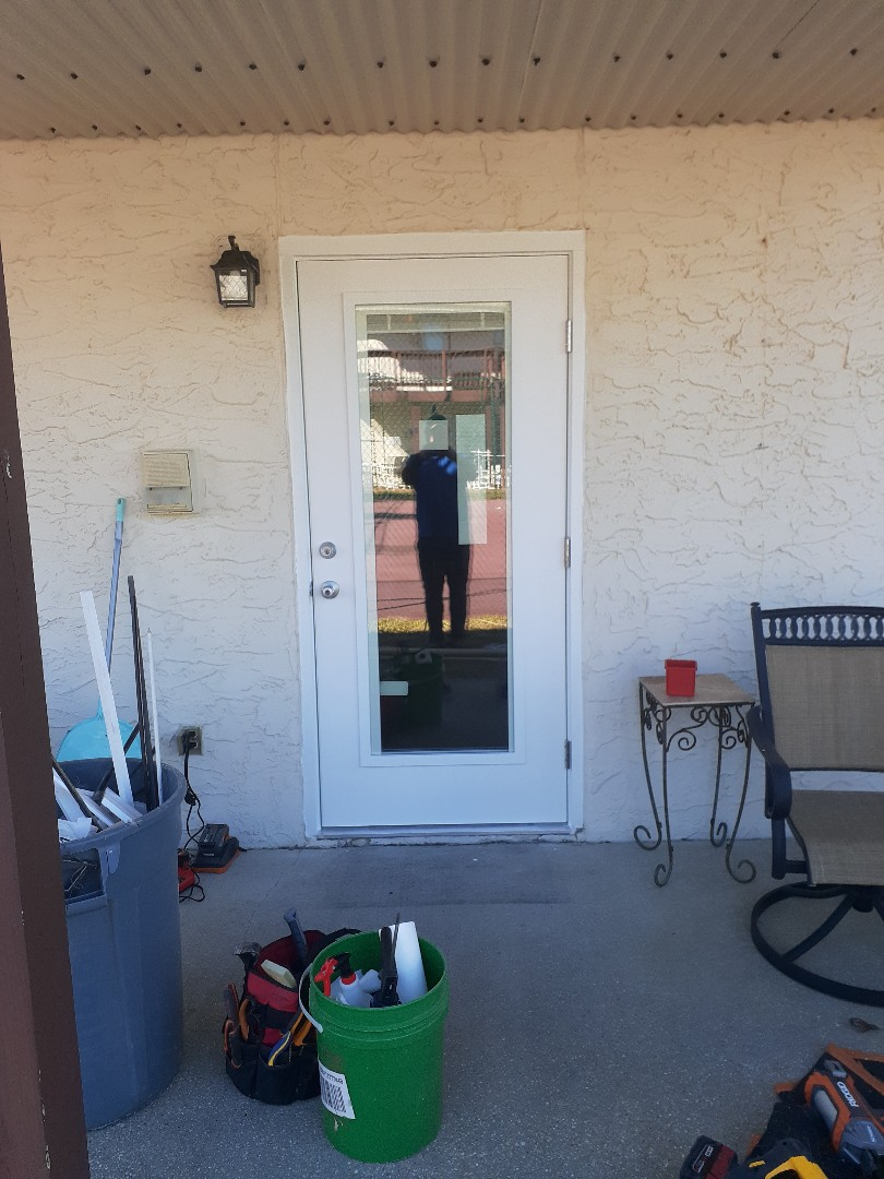 Boise walk door with Impact glass installed cleaned and caulked by Folkers Window Company.