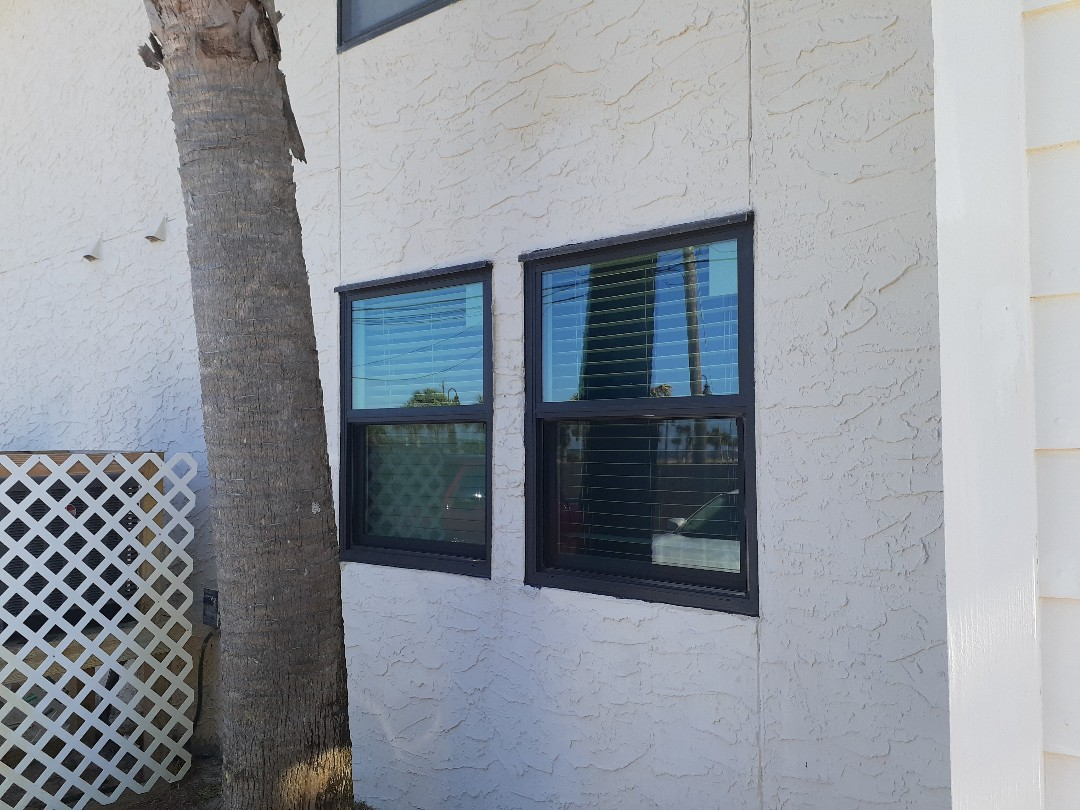 Gulf Breeze, FL - Four shwinco windows Impact rated installed cleaned and caulked
