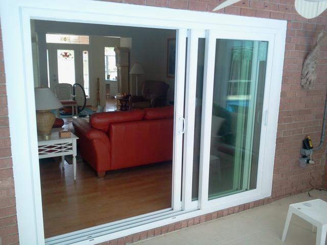 Orange Beach, AL - Installing tri-panel sliding glass door