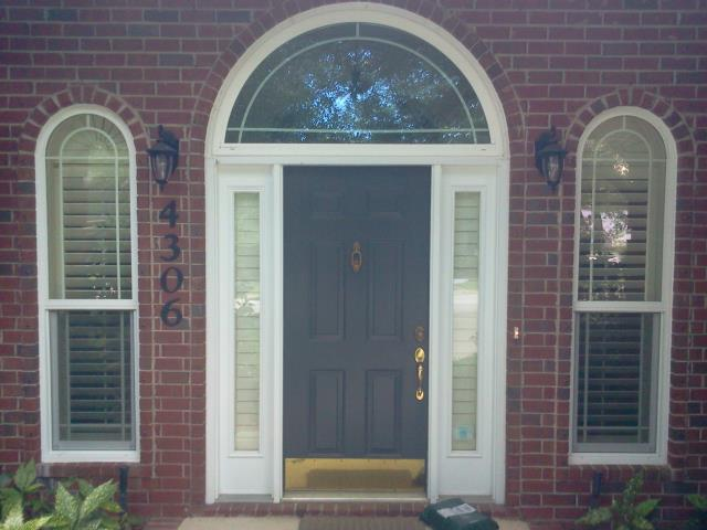 Milton, FL - Large entry door with two sidelights and half round transom all impact fiberglass door Boise Cascade.