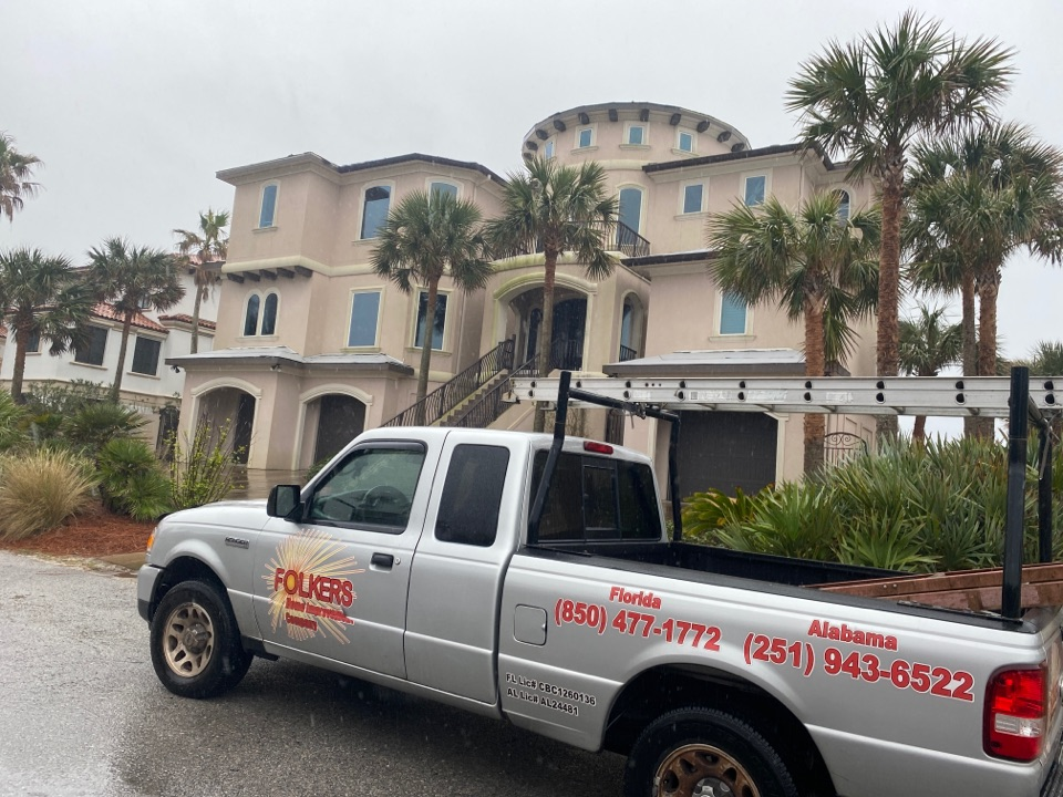 Pensacola Beach, FL - Measuring for impact replacement custom window systems sliding glass doors and swinging entry doors on Pensacola beach Florida