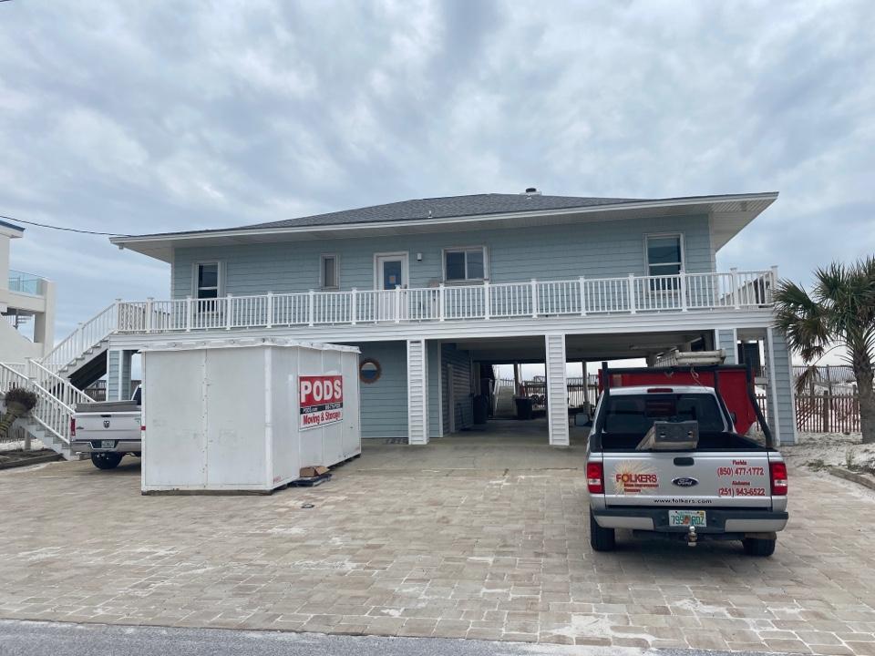 Pensacola Beach, FL - Measuring for impact replacement shwinco sliding glass doors and single hung windows on Pensacola beach Florida