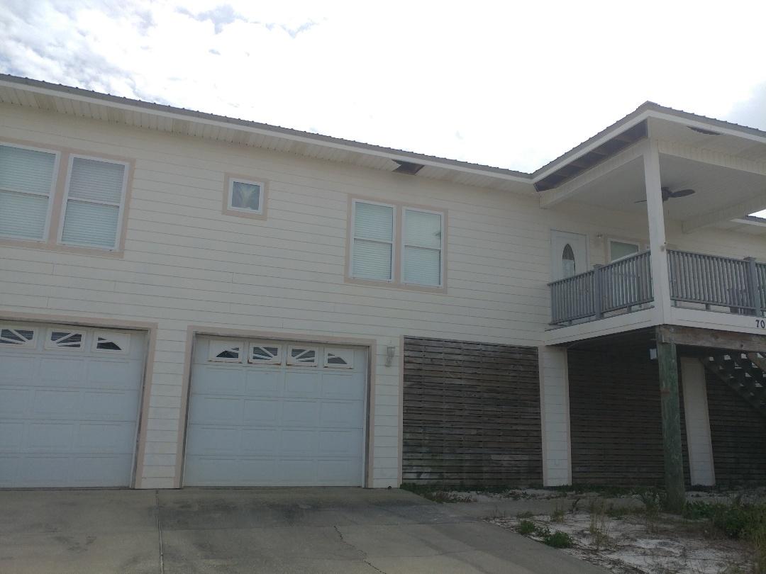 Pensacola Beach, FL - Finishing the house with impact windows