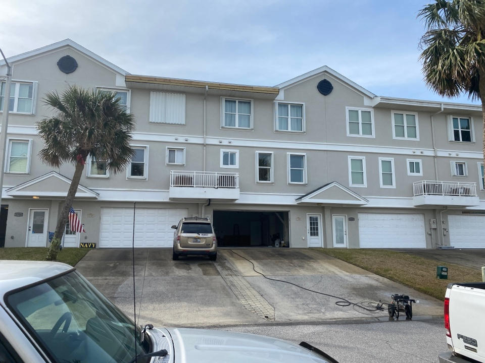 Pensacola Beach, FL - Measuring for impact replacement shwinco single hung windows and fixed picture windows on Pensacola beach Florida