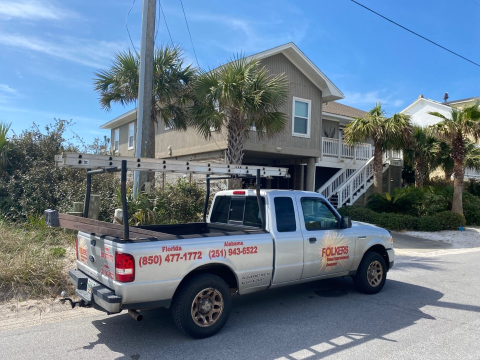 Pensacola Beach, FL - Measuring for impact replacement shwinco sliding glass doors and sliding windows on Pensacola beach Florida