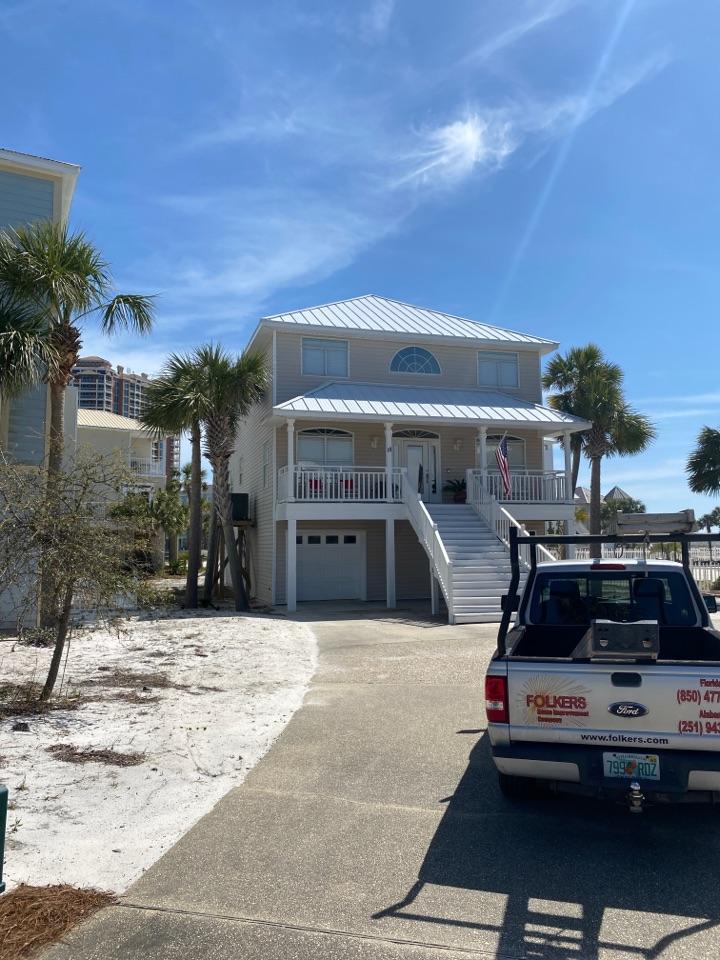 Pensacola Beach, FL - Measuring for impact replacement shwinco single hung windows on Pensacola beach Florida
