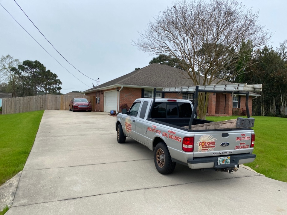 Navarre, FL - Measuring for impact replacement shwinco single hung windows and folkers hurricane storm panels in navarre Florida