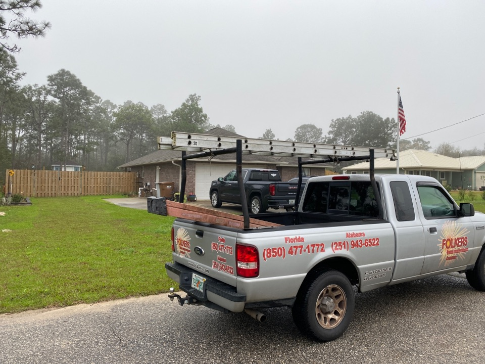 Navarre, FL - Measuring for impact replacement Viwinco double hung, casement and fixed picture windows in Navarre Florida