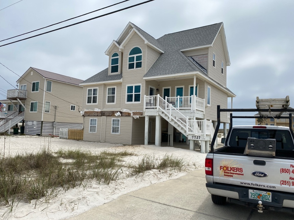 Navarre, FL - Measuring for impact replacement shwinco single hung windows and fixed picture windows on Navarre beach Florida