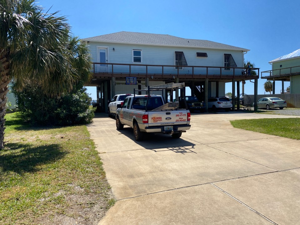Gulf Breeze, FL - Measuring for impact replacement custom window systems single hung windows and folkers colonial hurricane shutters in Tiger point gulf breeze Florida